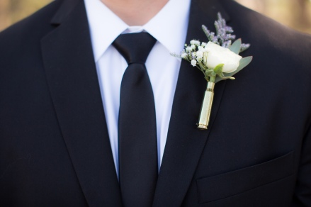 Totally in love with this bullet casing boutonnière. What you can't see is the engraving that is on it.  So manly and beautiful all at the same time!