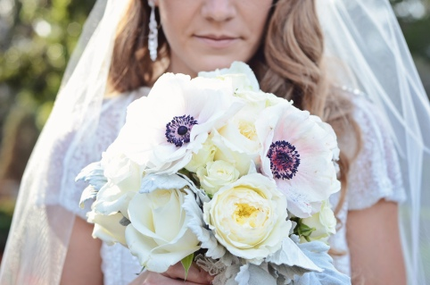 A collection of cream colored Patience Garden Roses, hybrid blush anemone, white anemone, dusty miller, ecuadorian white roses, and more made up this bridal bouquet.