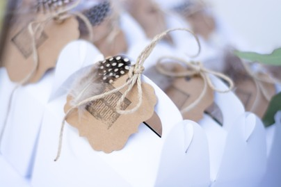 Boxed up S'More packages tied up with string and hand stamped cards with a little feather for charm.