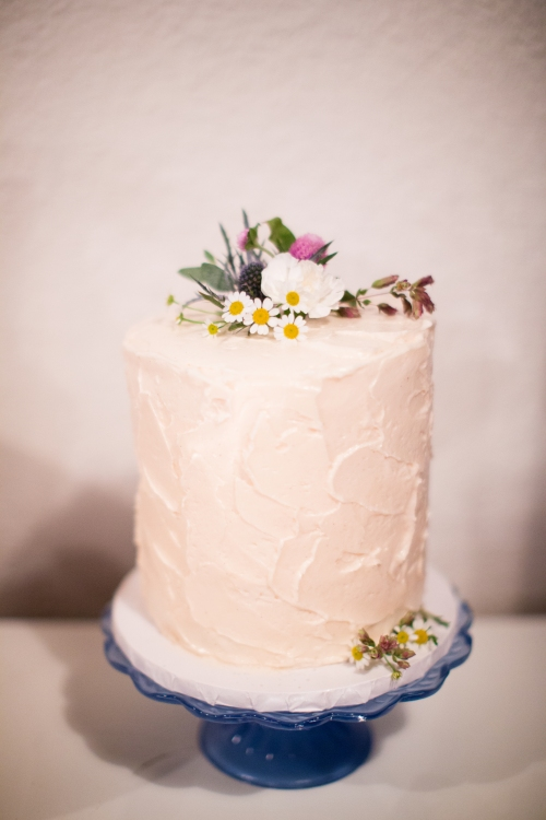Love fresh flowers on this delicious cake! But the poor cake started to tilt with the warm weather we've been having here in San Diego.